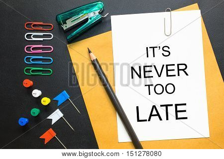 Text It's never too late on white paper background