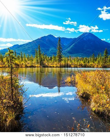 Concept of ecotourism. Rocky Mountains, Canada. Gorgeous sunset on the Vermilion Lakes in mountains of Banff National Park