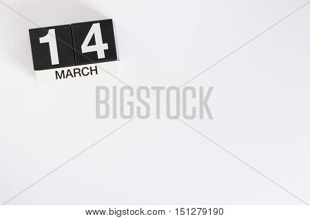 March 14th. Day 14 of month, wooden color calendar on white background. Spring time. Commonwealth and International pi days.
