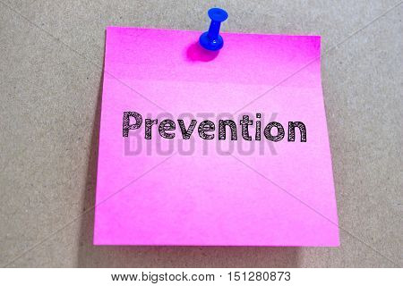 Text Prevention on pink paper note / business concept