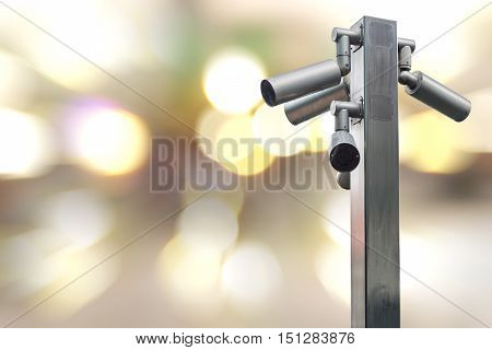 Closeup CCTV camera on colorful lighting background.