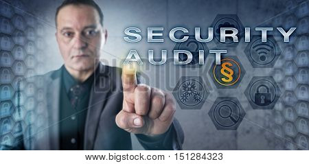 Mature male corporate auditor is activating a SECURITY AUDIT onscreen. Information technology concept and business metaphor for the process of examining the security risk of business information. poster