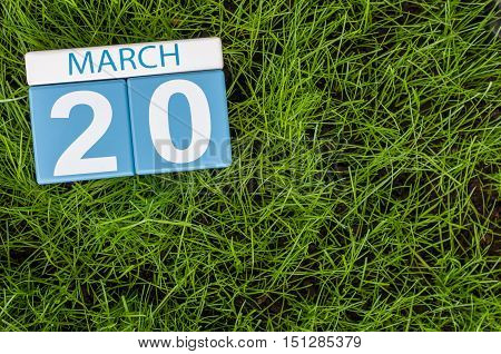 March 20th. Day 20 of month, calendar on football green grass background. Spring time, empty space for text.