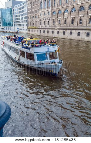 Berlin, Germany - April 2, 2008: Tourists Floating On A Boat On The Spree Near The Reichstag