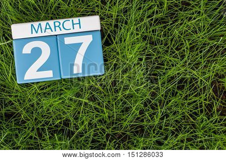March 27th. Day 27 of month, calendar on football green grass background. Spring time, empty space for text. World Theatre Days.