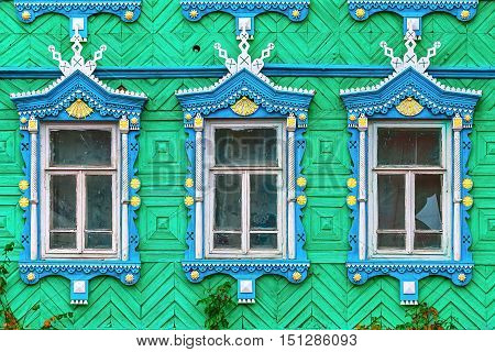 The massacre of old wooden Windows blue color green wall.