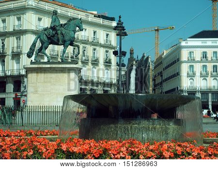 MADRID-MAY 12: The statue of Felipe III with fountain is seen in Plaza Mayor Madrid Spain Europe on May 12 2015.