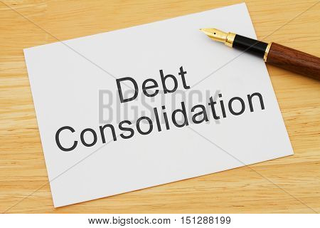 Getting a Debt Consolidation Loan A card and pen on a desk with text Debt Consolidation Loan