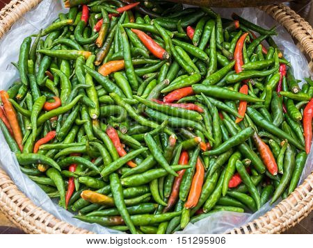 Red and green Fresh chilli peppers with top view.