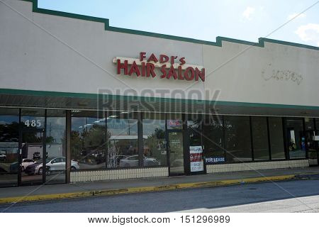BOLINGBROOK, ILLINOIS / UNITED STATES - SEPTEMBER 17, 2016: One may have one's hair cut and styled at Fadi's Hair Salon in Bolingbrook's River Woods Plaza strip mall.