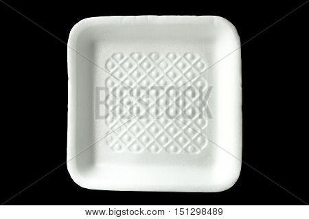 Empty plastic food polystyrene tray on black background