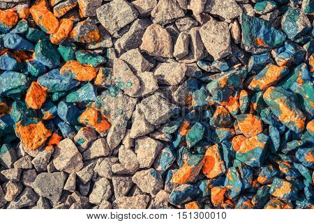 abstract background of gray stones and rocks covered with red paint view from above