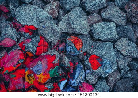 background gray stones and rocks painted in mottled red view from above