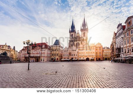 PRAGUE, CZECH REPUBLIC - JUNE 05, 2016: Kostel Panny Marie pred Tynem at the sunrise. Church of the Virgin Mary. Beautiful Old Town Square with the church without people in Romanesque - Gothic style.