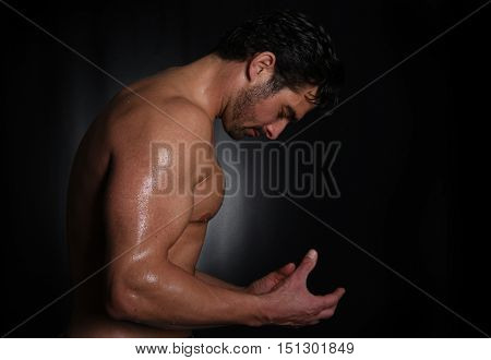 very Strong Image of a Body Builder In Studio