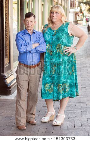Transgender Couple With Skeptical Expression