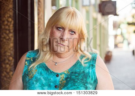 Skeptical Transgender Woman In Green Dress