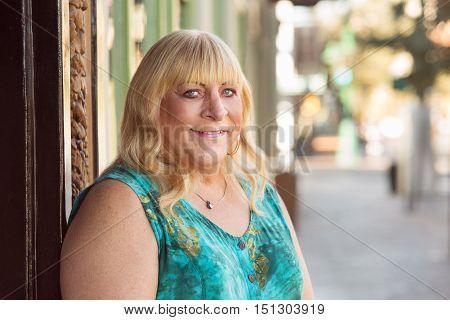 Transgender Blond Lady Smiling Outside
