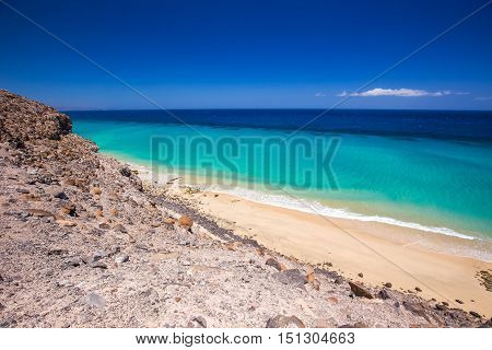 Sandy Beach With Vulcanic Mountains On Fuerteventura Island, Canary Islands, Spain.