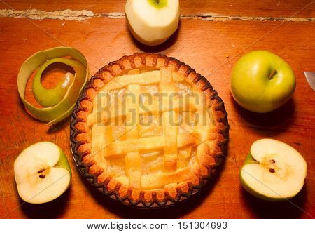 Delicious fresh apple pie dessert surrounded by fruits. Country baking background