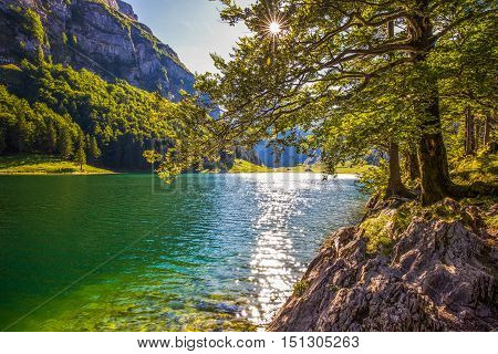 Tourquise clear Seealpsee with the Swiss Alps (mountain Santis) in the background Appenzeller Land Switzerland