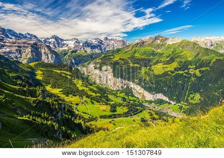 Famous Lauterbrunnen Valley With Gorgeous Waterfall And Swiss Alps In The Background From Mannlichen