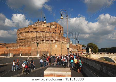 ROME, ITALY - SEPTEMBER 30: Tourists walking toward Castel Sant'Angel (Castle of Holy angel) a city landmark SEPTEMBER 30, 2016 in Rome, Italy