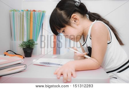picture of children doing home work .