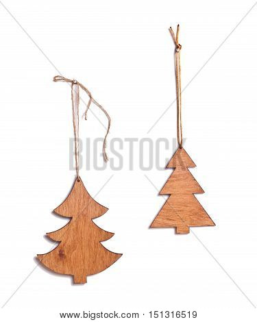 Wooden Christmas trees on a white background. Handmade Christmas decoration