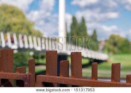 Steel girders and supports leading to the Christchurch suspension foot bridge over the River Thames in Reading.