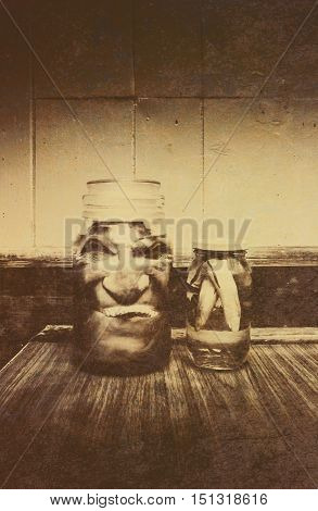 Vintage Halloween Decorations - Severed and Preserved Head and Hand in Jars of Liquid on Rustic Wooden Table