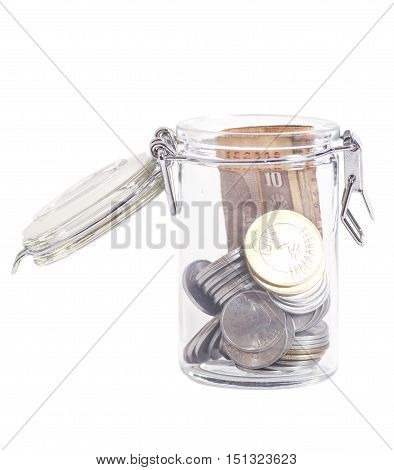 Money Indian Currency Rupee Notes and Coins in a glass jar isolated