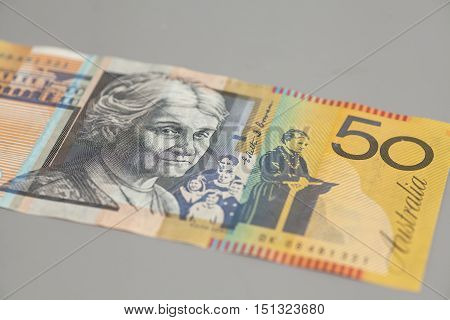 Australian fifty dollar bank note on gray background