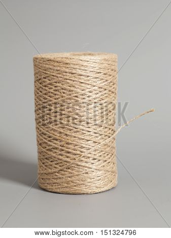 Skein of jute twine on gray background