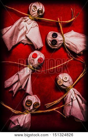 Haunting halloween ghouls and ghosts with candy monsters made from lollipops and tissues with creepy button eyes. Spooky trick or treaters