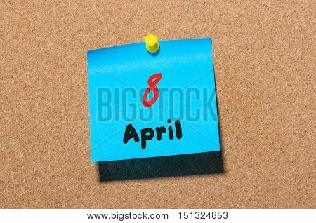 April 8th. Day 8 of month, calendar on cork notice board, business background. Spring time, empty space for text.