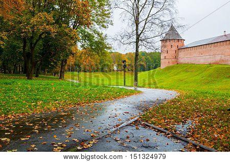 Veliky Novgorod Russia - Novgorod Kremlin fortress tower in rainy autumn weather. Architecture view of autumn park and Veliky Novgorod Kremlin Russia
