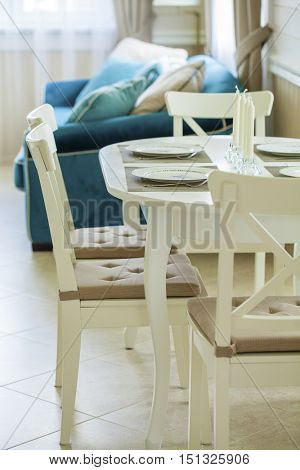 Kitchen table with four wooden chairs. Interior living room