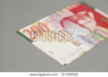 Two hundred sheqalim isolated on gray background