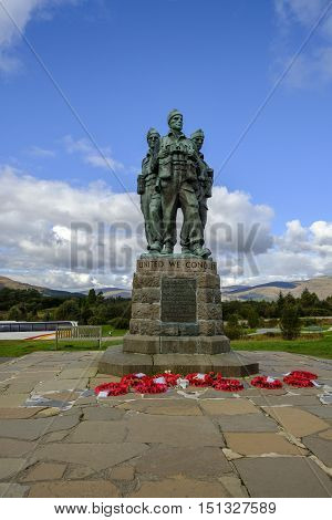 SPEAN BRIDGE SCOTLAND - 1 Oct 2016: Against the beautiful Scottish Highalnds landscape poppy wreaths lie at the foot of the Commando Memorial a cast bronze sculpture of three commandos in uniform dedicated to the British Commando Forces who trained here i
