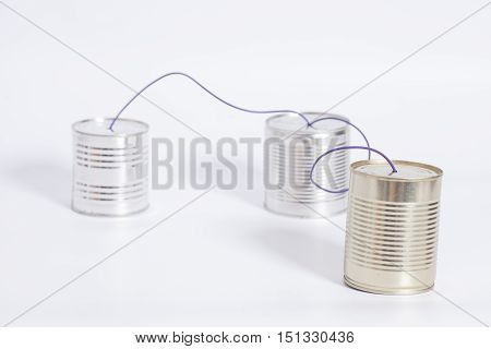 tin can phone on white .communication concept