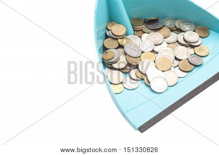 coins in blue dustpan isolated on white