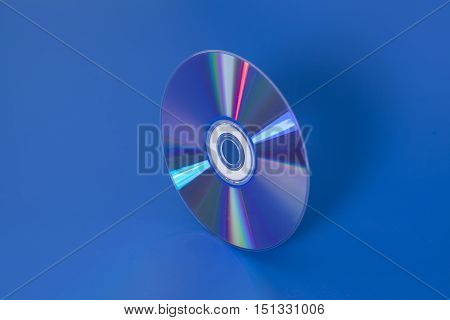 Compact disk shiny on a blue background
