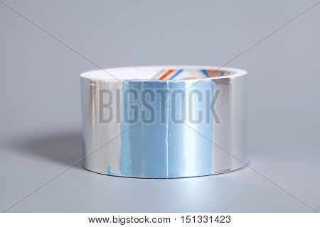Duct tape roll silver repair reel on gray background