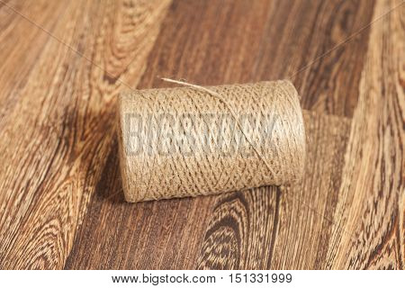 Skein of jute twine on wooden background