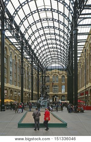 LONDON UNITED KINGDOM - NOVEMBER 23: Hays Galleria With Tourists in London on NOVEMBER 23 2013. Hays Wharf at Southwark in London United Kingdom.