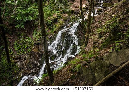 Shepit waterfall in west Ukraine view from top. Carpathian mountains, summer.