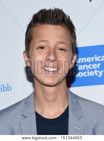 LOS ANGELES - SEP 09:  Mitch Carbon arrives to the Stand Up To Cancer 2016 on September 09, 2016 in Hollywood, CA
