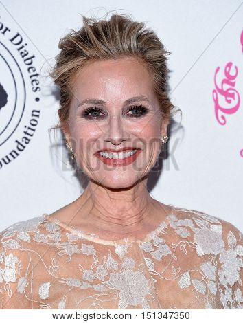 LOS ANGELES - OCT 8:  Maureen McCormick arrives to the Carousel of Hope 2016 on October 8, 2016 in Hollywood, CA