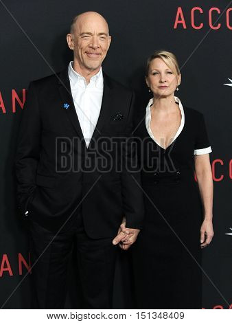 LOS ANGELES - OCT 10:  J.K. Simmons & Michelle Schumacher arrives to